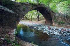 Medieval bridge Tielefos. Medieval bridge Tielefos - ancient stone bridge across a narrow mountain river. Cyprus Stock Image