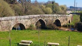 Medieval bridge in Tui Way of Santiago stock images