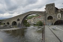 Medieval bridge in the village of Camprodon. The main symbol of the city of Camprodon is the New Bridge built in the XII century, this bridge is also depicted on Stock Images