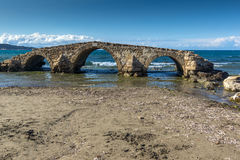 Medieval bridge in the water at Argassi beach, Zakynthos island Royalty Free Stock Photo