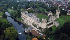 Medieval British Castle. Warwick Castle is a medieval castle developed from an original built by William the Conqueror in 1068 Royalty Free Stock Images