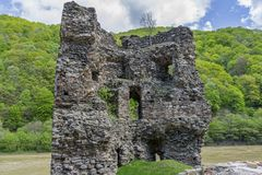 Medieval broken tower. The custom-house on Olt river in Carpathian mountains. Stock Photos