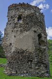 Medieval broken tower. The custom-house on Olt river in Carpathian mountains. Royalty Free Stock Images