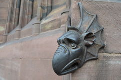 Medieval bronze dragon at a gothic cathedral Stock Photos