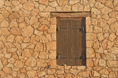 Medieval brown window shutters on sunny day Royalty Free Stock Photo