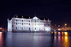 Medieval building in Amsterdam at night in Netherlands Royalty Free Stock Images