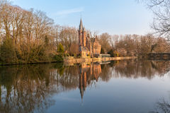 Medieval building (Castle) on Love lake in Bruges, Belgium Royalty Free Stock Image