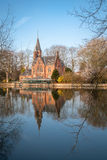 Medieval building (Castle) on Love lake, Minnewater Park in Bruges, Belgium Royalty Free Stock Photo