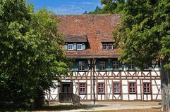 Historic building in monastery yard of Blaubeuren, Germany. Medieval building with half-timbered facade in monastery yard of Blaubeuren, Germany Royalty Free Stock Image