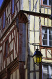 Medieval building with lamp in Dinan Stock Photo
