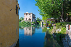 Medieval building upon the Mincio river in Borghetto. Verona, Italy Royalty Free Stock Images