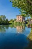 Medieval building upon the Mincio river in Borghetto. Verona, Italy Stock Photos