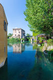 Medieval building upon the Mincio river in Borghetto. Verona, Italy Royalty Free Stock Photo