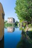 Medieval building upon the Mincio river. In Borghetto, Verona, Italy Stock Photos