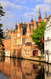 Medieval buildings along a canal in Bruges, Belgium Stock Photo