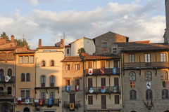 Medieval buildings in Arezzo (Tuscany, Italy). At evening Stock Photos