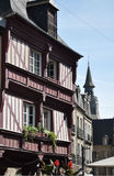 Medieval buildings and clock tower in Dinan Stock Photo