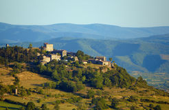 The medieval buildings on a hill in the evening. In France Stock Photo