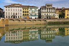 Medieval buildings on quay of Arno Stock Photos