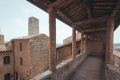 Medieval Buildings and Tower of San Gimignano, Italy stock photos