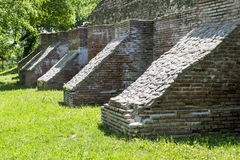 Medieval buttresses. Medieval brick buttresses used to increase the strength of a citadels wall Stock Image