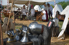 Medieval camp with armor. And people stock photography