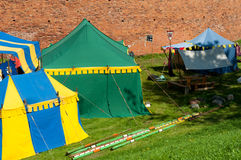 Medieval camp. View of historical medieval camp tents by the castle wall Stock Photos