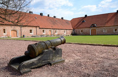 Medieval cannon. Old cannon in Swedish castle porch Royalty Free Stock Image