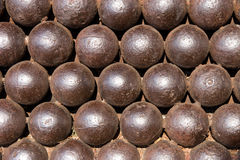 Medieval cannon-balls in a row Royalty Free Stock Images