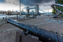 Medieval cannon and Sunset view of Tower Bridge in London, United Kingdom Royalty Free Stock Image