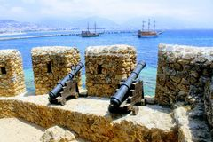 Medieval cannons and the fortress wall of Alanya Castle Alanya, Turkey Royalty Free Stock Image