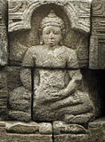 Medieval carving - Buddha. Borobudur temple. Royalty Free Stock Image