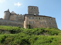 Medieval Castle. Medieval european castle in the Czech Republic viewed from the valley below Royalty Free Stock Images