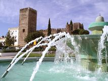 Medieval Castle. In Portuguese Village and fountain in the foreground Royalty Free Stock Photo