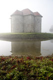 Medieval castle. Wrapped in a morning fog Royalty Free Stock Photos