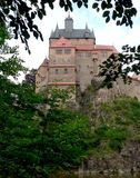 Medieval castle. Looking through trees to a medieval castle built on a cliff Royalty Free Stock Photo