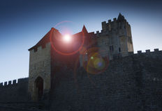 Medieval castle. Back lit by sun causing interesting lens flare Stock Photo