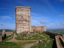 Medieval castle. Main tower of a medieval castle in the south of Extremadura (Spain stock photos