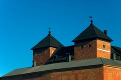 Medieval castle. With towers against a deep blue sky Royalty Free Stock Photography