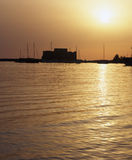 Medieval Castle. Of Paphos, Cyprus at sunset with the sea turning to liquid gold royalty free stock image