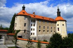 Medieval Castle in Skofja Loka, Slovenia. Medieval Castle against a clouded sky in old town of Skofja Loka - Slovenia, Europe stock photos