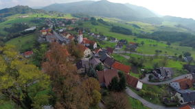 Medieval castle with a beautiful view. Helicopter camera flying across the midlives castle in the middle of the beautiful landscape on sunny summer day stock video footage