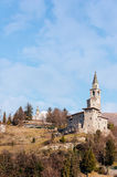 Medieval castle and bell tower . Medieval castle in Italy in the foothills of the Alps Stock Photography