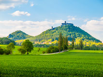 Medieval castle Bezdez on the mountain top. Sunny summer day with lush green fields in Czech landscape. Czech Republic Stock Image
