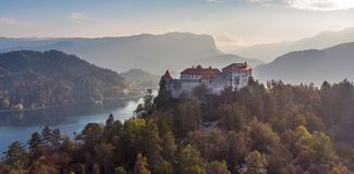Medieval castle on Bled lake in Slovenia in autumn. stock photography