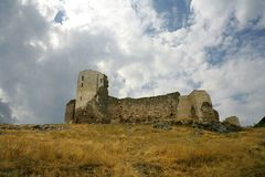 Medieval Castle with blue sky and clouds. The Ruins of Medieval Castle Stock Photo