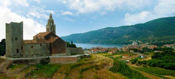 Medieval castle church in Mediterranean. Panoramic view of the medieval castle church on the Mediterranean coast Royalty Free Stock Photography