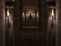 Medieval castle corridor. Dark medieval castle corridor with columns and torches Royalty Free Stock Image