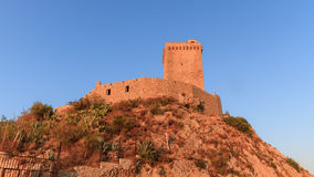 Medieval Castle at the Costaline of Palermo. Shining in the setting sun Stock Photos