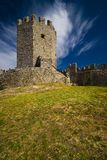 Medieval Castle with deep blue sky and clouds. The Ruins of Medieval Castle at the Olympic Riviera Coast stock photo